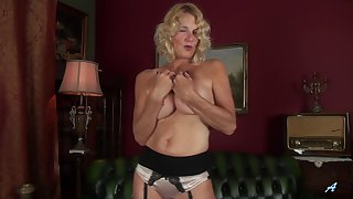 Busty blonde mature Molly Maracas pleasures her shaved snatch
