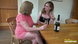 Two horny mature lesbians slowly stripping and bringing off with their huge gut